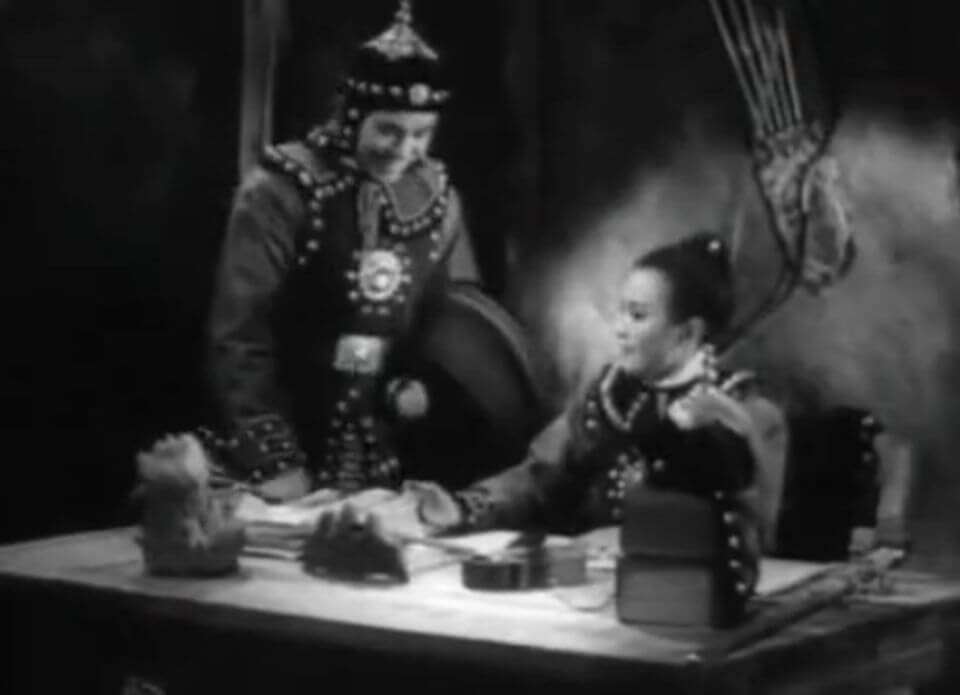 Mulan and Yuandu discussing military plans in the 1939 film Mulan Joins the Army. ©1939 China United Productions.